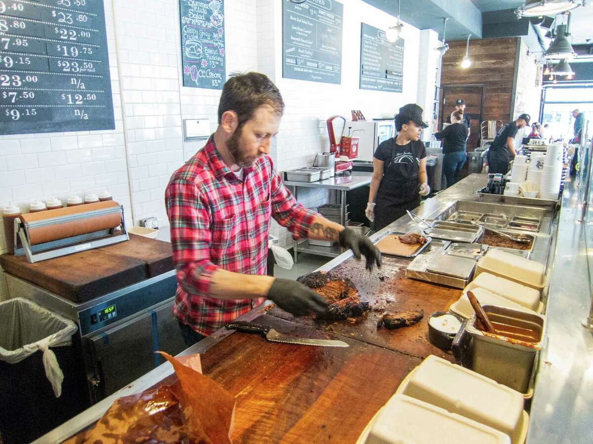 Hugh Mangum works at the chopping block at Mighty Quinn's Barbeque in the East Village in New York City.