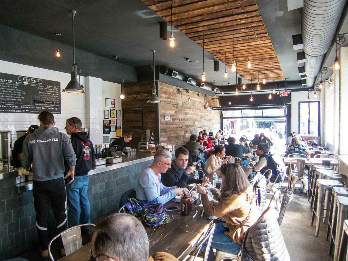 The dining room at Mighty Quinn's Barbeque - East Village in New York City