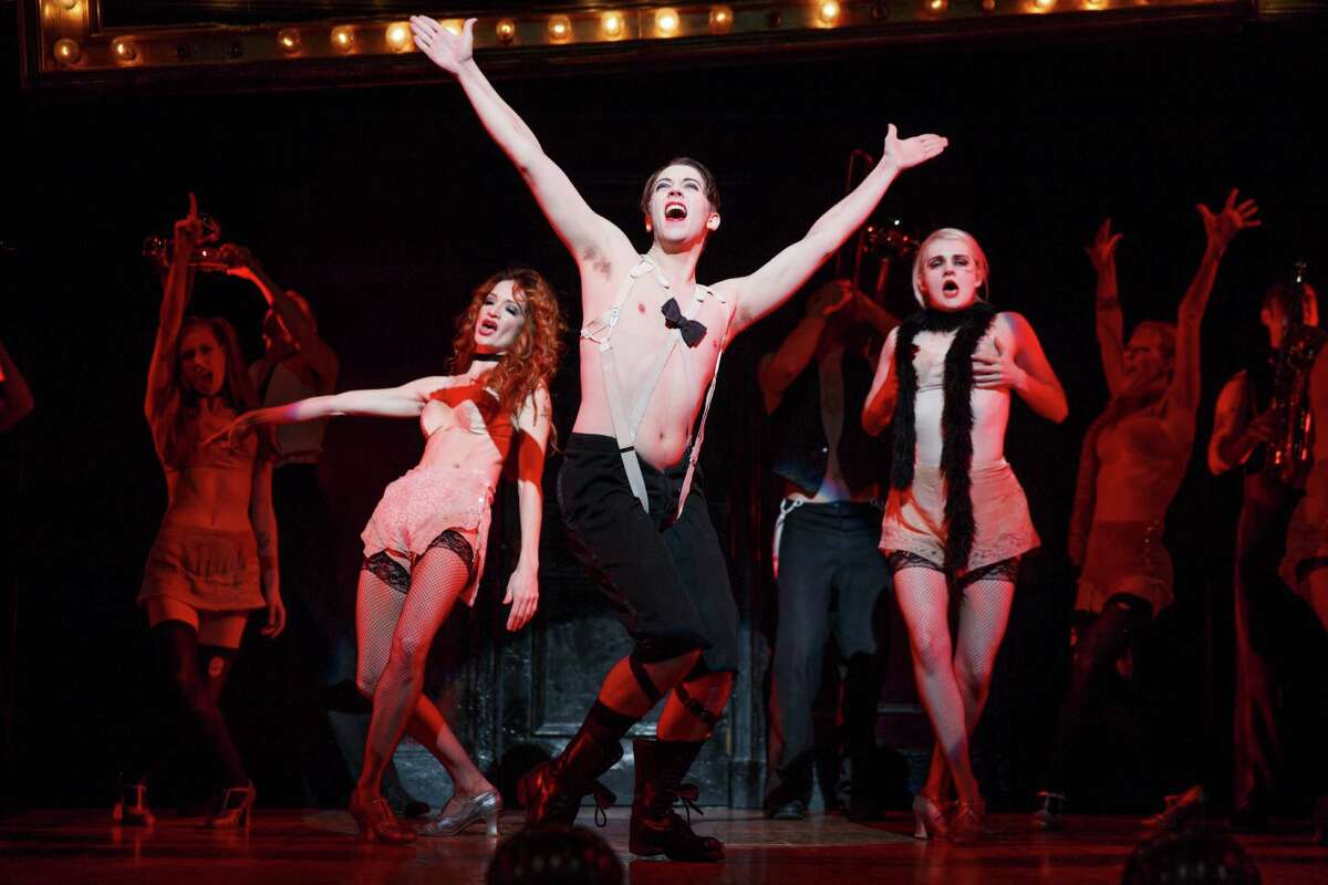 """The Kit Kat Klub, led by the Emcee, provides an escape from reality in Broadway at the Hobby Center's """"Cabaret."""""""