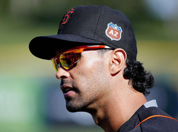 San Francisco Giants' Angel Pagan takes the field for a spring training baseball workout, Tuesday, Feb. 23, 2016, in Scottsdale, Ariz.  (AP Photo/Matt York)