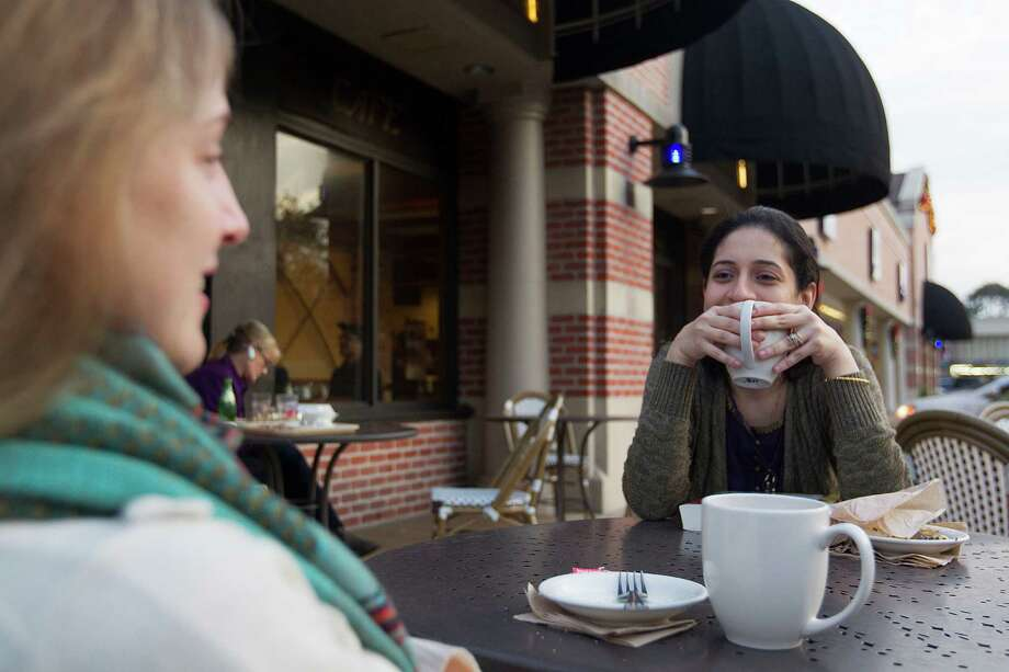 Friends share coffee and conversation outside of the La Madeleine restaurant at the Rice Village Arcade. ( Johnny Hanson / Houston Chronicle ) Photo: Johnny Hanson, Staff / © 2014  Houston Chronicle