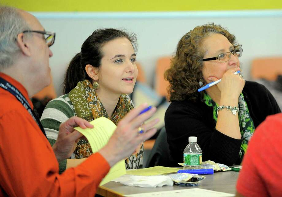 Stephanie Cahill, an educator at Westhill High School and her mother, Maria Cahill, an Stamford High School educator, listen to instructors teaching a lesson in German during a class at the Stamford Government Center in Stamford. Photo: Matthew Brown / Hearst Connecticut Media / Stamford Advocate