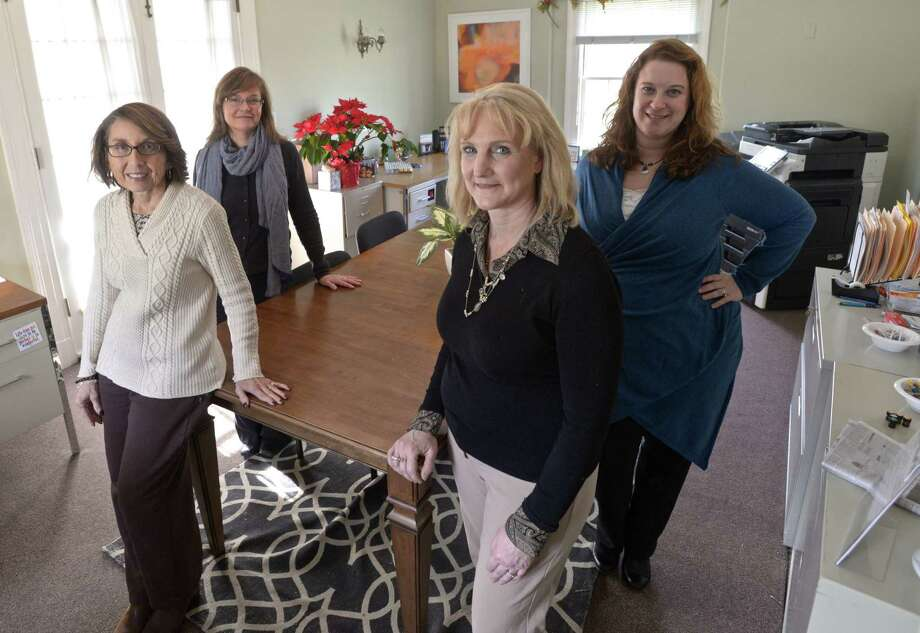 Four of the six members of the Newtown Recovery and Resiliency Team in their office is on the Fairfield Hills Campus in December. Pictured are Deb DelVecchio-Scully, front left, clinical recovery leader; Melissa Glaser, front right, community outreach liaison; Catherine Galda, back left, case coordinator; and Margot Robins, back right, project manager. Photo: H John Voorhees III / Hearst Connecticut Media / The News-Times