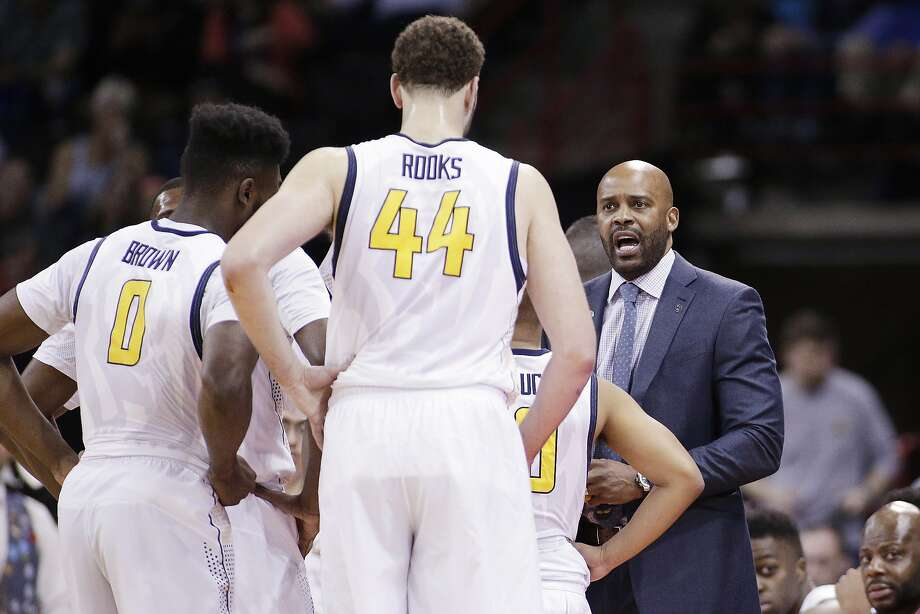 California head coach Cuonzo Martin, right, speaks with his team in a timeout during the first half of a first-round men's college basketball game against Hawaii in the NCAA Tournament in Spokane, Wash., Friday, March 18, 2016. (AP Photo/Young Kwak) Photo: Young Kwak, AP
