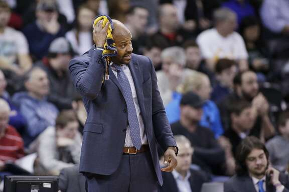 California head coach Cuonzo Martin wipes his head with a towel during the first half of a first-round men's college basketball game against Hawaii in the NCAA Tournament in Spokane, Wash., Friday, March 18, 2016. (AP Photo/Young Kwak)