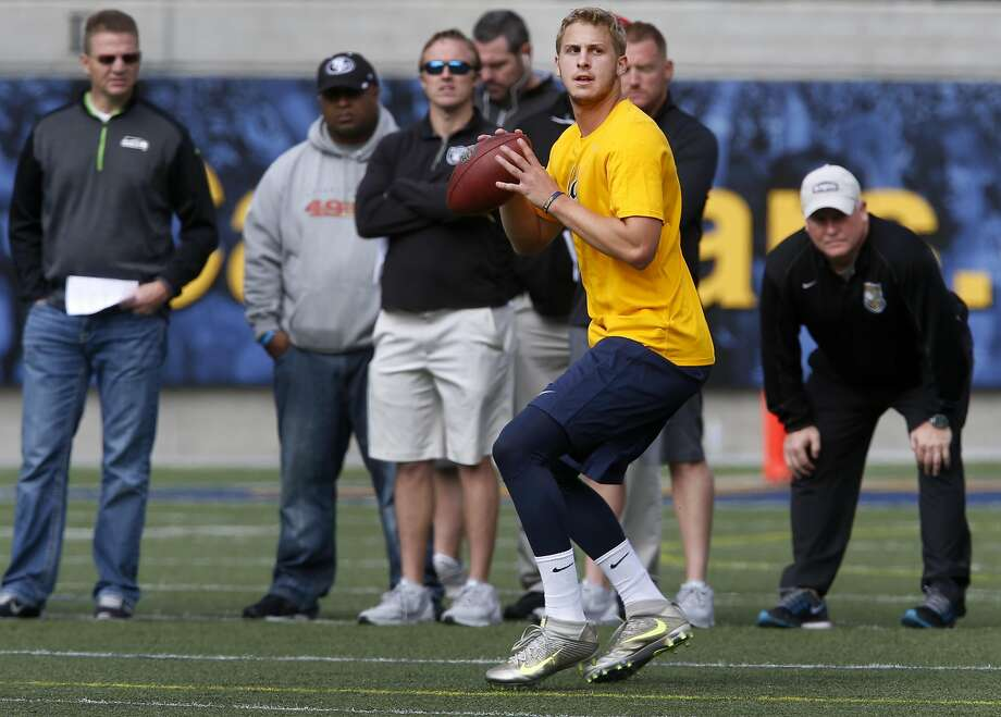 Quarterback Jared Goff auditions in front of NFL scouts and coaches, including 49ers head coach Chip Kelly (right), at the California Golden Bears Pro Day at Memorial Stadium in Berkeley, Calif. on Friday, March 18, 2016. Photo: Paul Chinn, The Chronicle