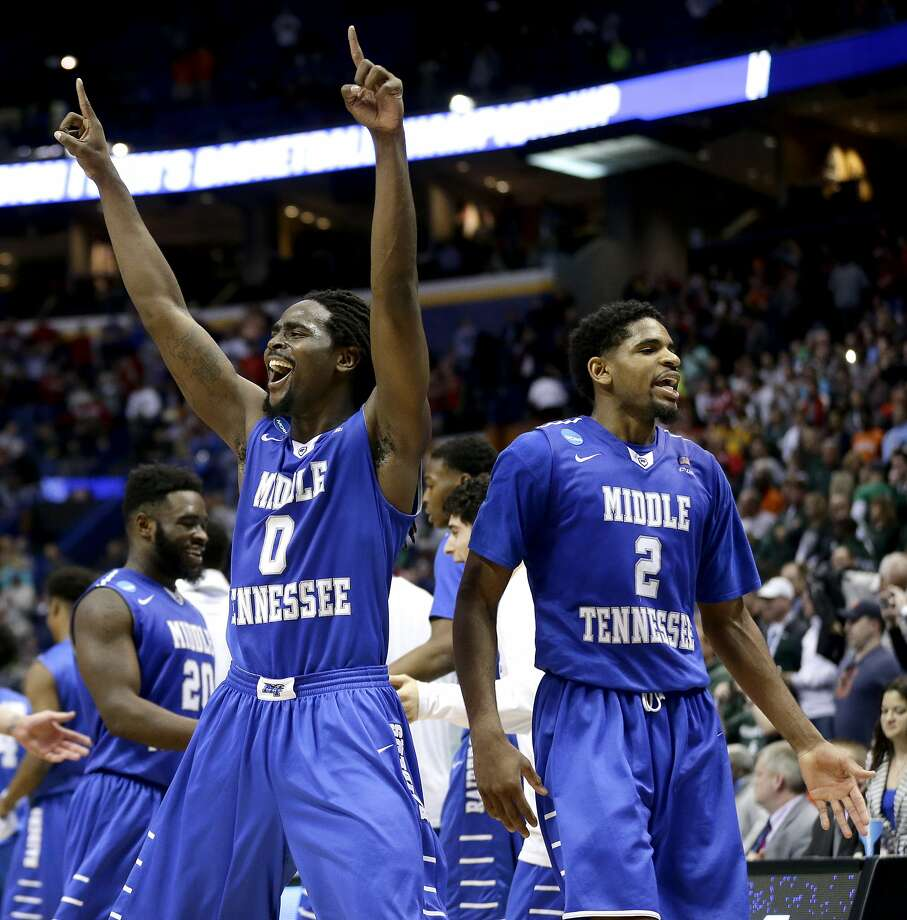 Middle Tennessee's Darnell Harris (0) and Perrin Buford (2) celebrate after beating Michigan State in St. Louis. Photo: Charlie Riedel, AP