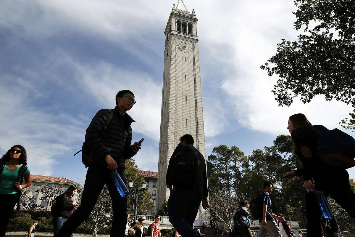 Students pass in front of the Campanile Tower on the Cal campus in Berkeley in this Feb. 11, 2016 photo.