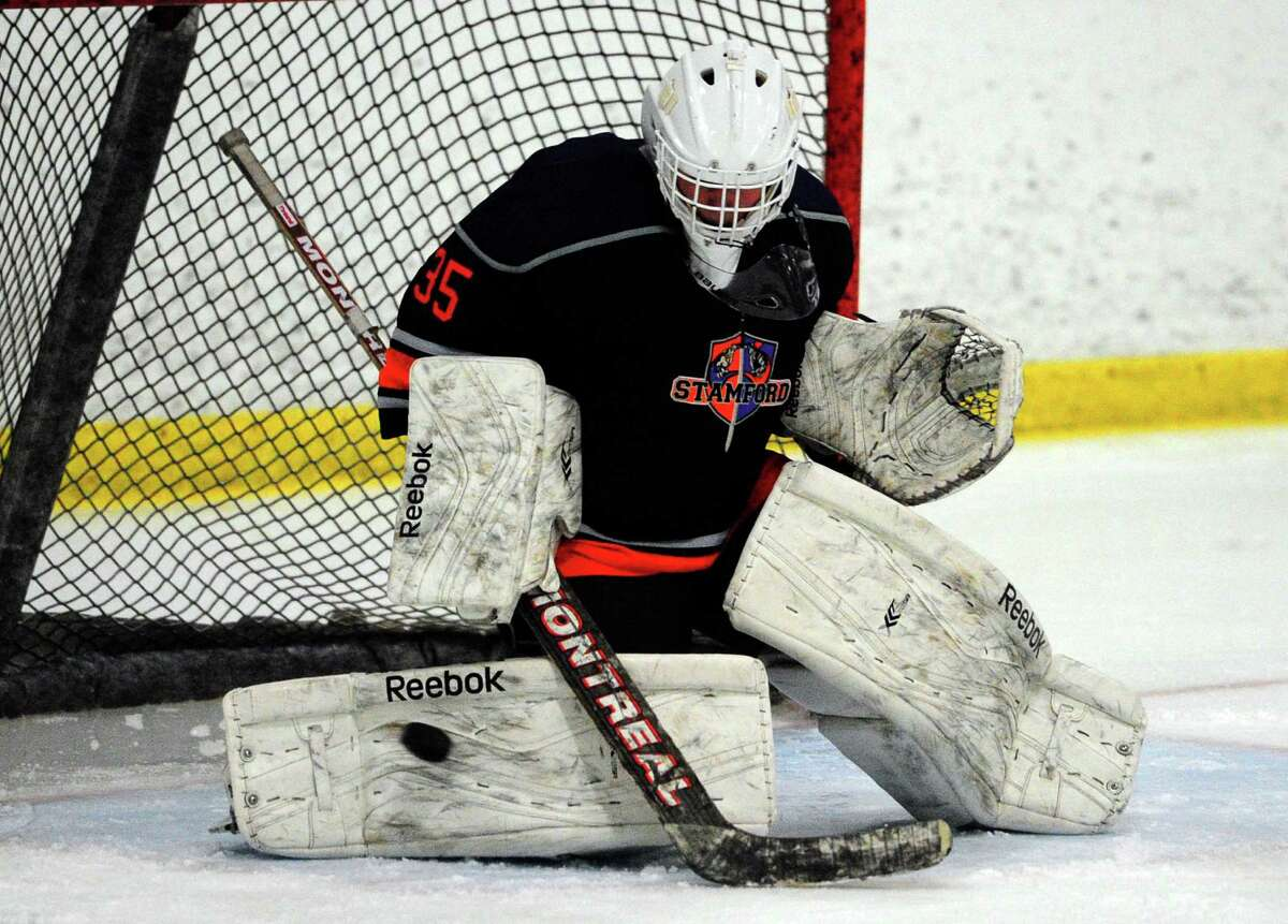 Stamford Co-op goalie Christian Compolattaro in boys hockey action between Stamford Co-op and St. Joseph at The Rinks in Shelton, Conn., on Thursday Feb. 18, 2016.