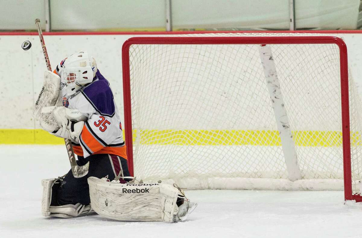 The Westhill-Stamford co-op team goalie Christian Compolattaro makes a save during a boys ice hockey game against Masuk High School played at Terry Connors Rink, Stamford, CT on Saturday, January 2, 2016.