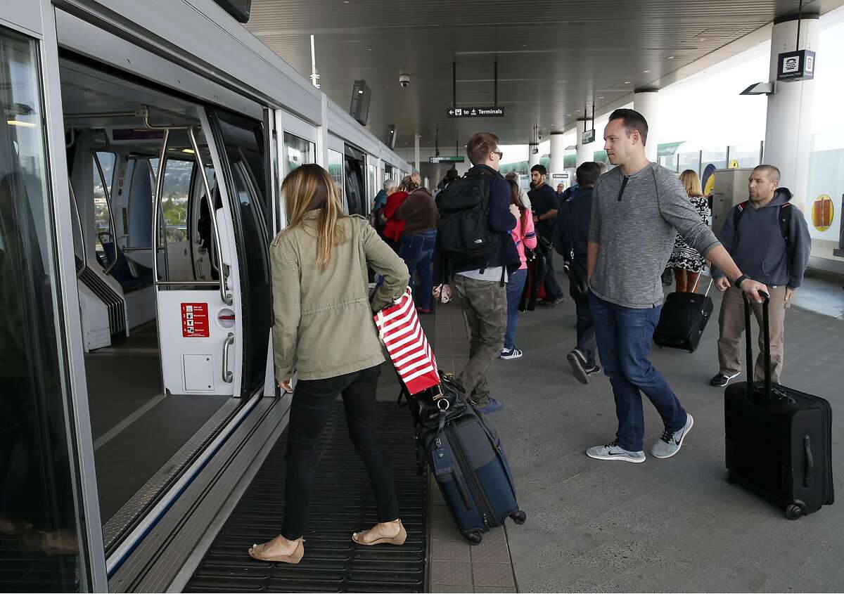 Passengers transit to and from Oakland International Airport at the Coliseum station on the BART Oakland Airport Connector line in Oakland, Calif. on Friday, March 18, 2016.