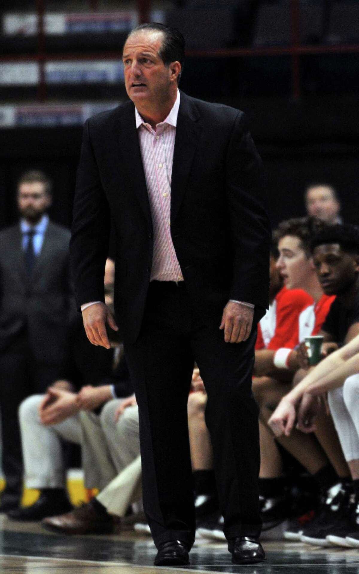 Coach Brian Fruscio of Albany's Academy boys basketball is unhappy with his team's personal foul during the second quarter of the Federation Tournament of Champions Class A basketball game between Albany Academy and Canisius High School. Photo taken on Friday, March 19, 2016, in the Times Union Center, Albany, N.Y. (Brittany Gregory / Special to the Times Union)