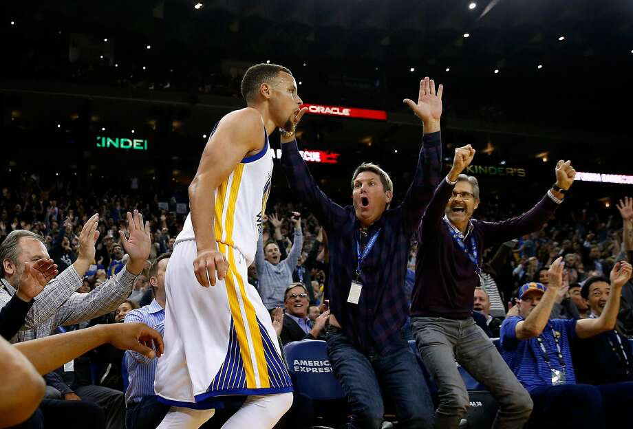 OAKLAND, CA - MARCH 14:  Fans react after Golden State Warriors made a three-point basket against the New Orleans Pelicans at ORACLE Arena on March 14, 2016 in Oakland, California. NOTE TO USER: User expressly acknowledges and agrees that, by downloading and or using this photograph, User is consenting to the terms and conditions of the Getty Images License Agreement.  (Photo by Ezra Shaw/Getty Images) Photo: Ezra Shaw, Getty Images