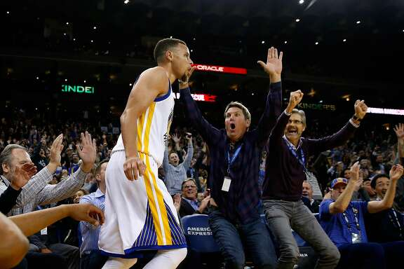 OAKLAND, CA - MARCH 14:  Fans react after Golden State Warriors made a three-point basket against the New Orleans Pelicans at ORACLE Arena on March 14, 2016 in Oakland, California. NOTE TO USER: User expressly acknowledges and agrees that, by downloading and or using this photograph, User is consenting to the terms and conditions of the Getty Images License Agreement.  (Photo by Ezra Shaw/Getty Images)