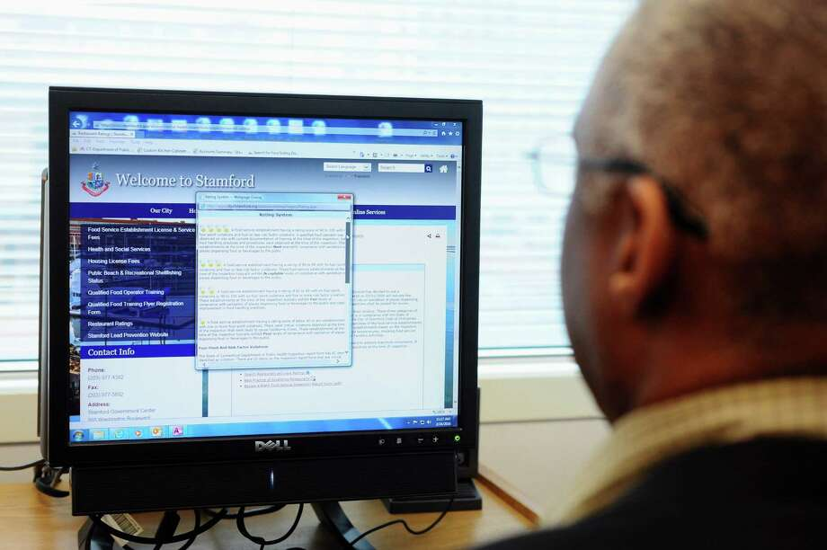 Ron Miller, Director of Environmental Inspections for the City of Stamford, scrolls through the city's restaurant reviews website in his office on Wednesday, Feb. 24, 2016. Photo: Michael Cummo / Hearst Connecticut Media / Stamford Advocate