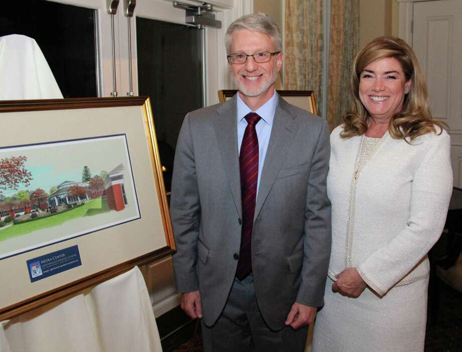 Jim Dougherty, a Greenwich Catholic School alumnus and trustee of a family trust that has made a $250,000 challenge gift to the school, and his wife, Sue Dougherty, stand next to an architect's drawing showing the renovation of the school's upper-school building, during a recent reception at the Tamarack Country Club. Photo: Contributed Photo