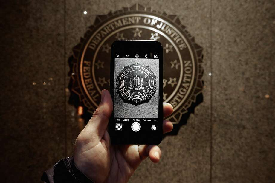 An iPhone's camera screen shows the official seal of the FBI, the agency that paid for an iPhone hacking tool. Photo: Chip Somodevilla, Getty Images