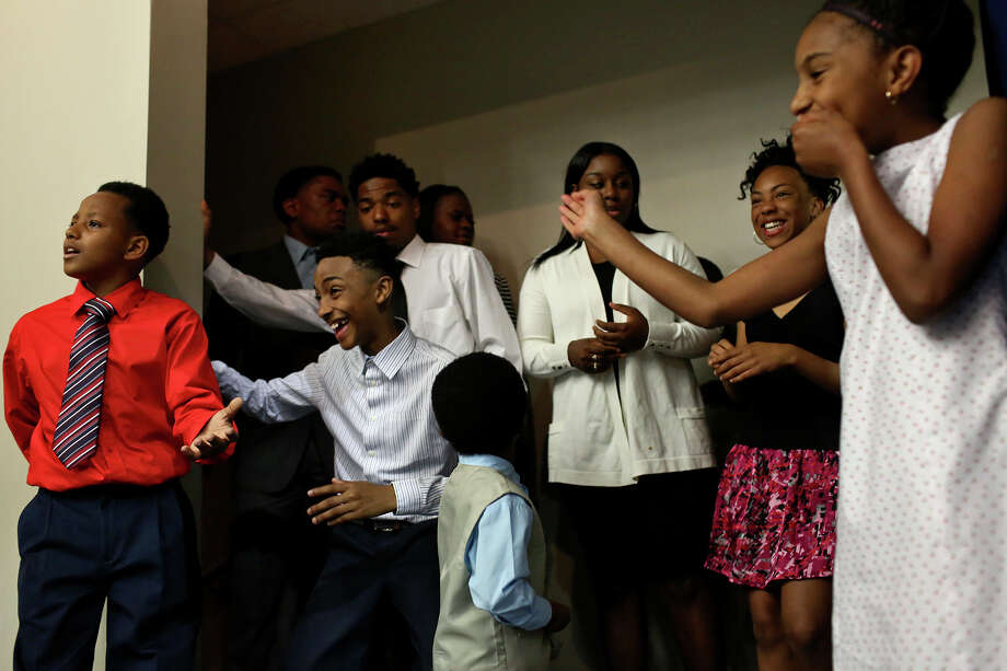 "Ray Hardie, 11, from left, Jaden White, 13, Charles Daniels, 17, Ebreyiah McCaskill, 17, Amirah Perry, 13, and Jerzi White, 10, wait their turn to walk on stage for the SUIT UP! fashion show during the 2016 Inaugural Teen Summit at Second Baptist Church Community Center in San Antonio on Friday. SUIT UP! Business and Professional Clothing Exchange Program is a ""community initiative to collect new/ gently worn professional attire for teens/adults entering or re-entering the workforce"" created by Walter Perry, also a Teen Summit organizer. Photo: Lisa Krantz /San Antonio Express-News / SAN ANTONIO EXPRESS-NEWS"