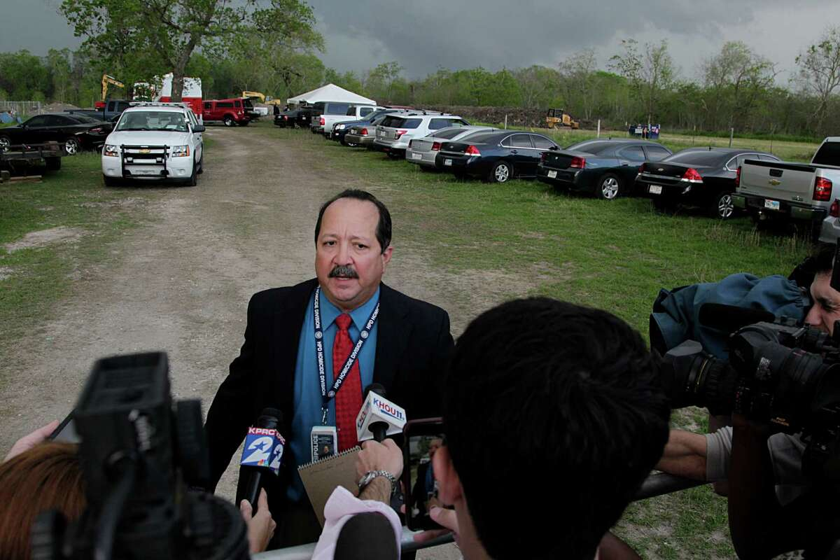 Richard Martinez with the Houston Police Department Homicide Division speaks with reporters during the search for body of Jessica Cain in the 6100 of East Orem Friday, March 18, 2016, in Houston.