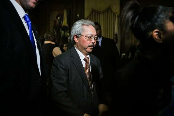 Mayor Ed Lee is escorted out of a press conference after speaking about police reforms in the wake of the Mario Woods killing, at City Hall, in San Francisco, California on Monday, February 22, 2016.