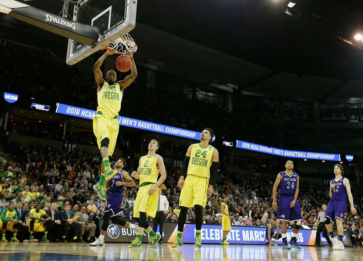 SPOKANE, WA - MARCH 18: Elgin Cook #23 of the Oregon Ducks dunks against the Holy Cross Crusaders in the second half during the first round of the 2016 NCAA Men's Basketball Tournament at Spokane Veterans Memorial Arena on March 18, 2016 in Spokane, Washington. (Photo by Patrick Smith/Getty Images)
