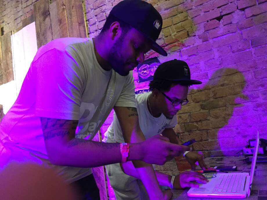Richie Branson and Solar Slim of Otaku Gang, admittedly geeky hip-hop/rap and gaming programmers brought music of the future to SxSW. Photo: Hector Saldana, San Antonio Express News