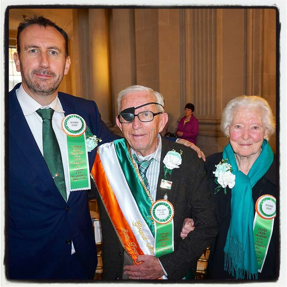 Irish Consul General Philip Grant (left) with St. Patrick's Day Parade Grand Marshal Jerry Boyle and his wife, Bridget, at City Hall. Photo: Catherine Bigelow, Special To The Chronicle