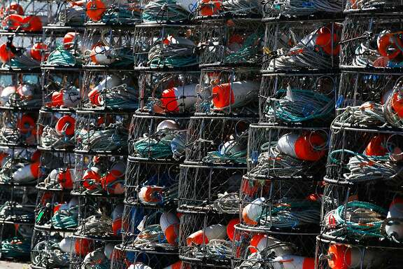 Crab fishing pots are stacked near the harbor in Santa Cruz, Calif. on Monday, February 8, 2016. The Small Business Administration is offering small disaster loans to businesses affected by the delayed dungeness crab season.
