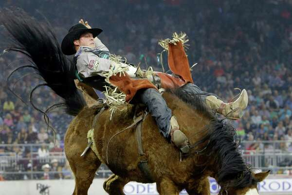 Richie Champion of The Woodlands competes in bareback riding at RodeoHouston during the Houston Livestock Show and Rodeo in NRG Stadium Friday, March 18, 2016, in Houston.
