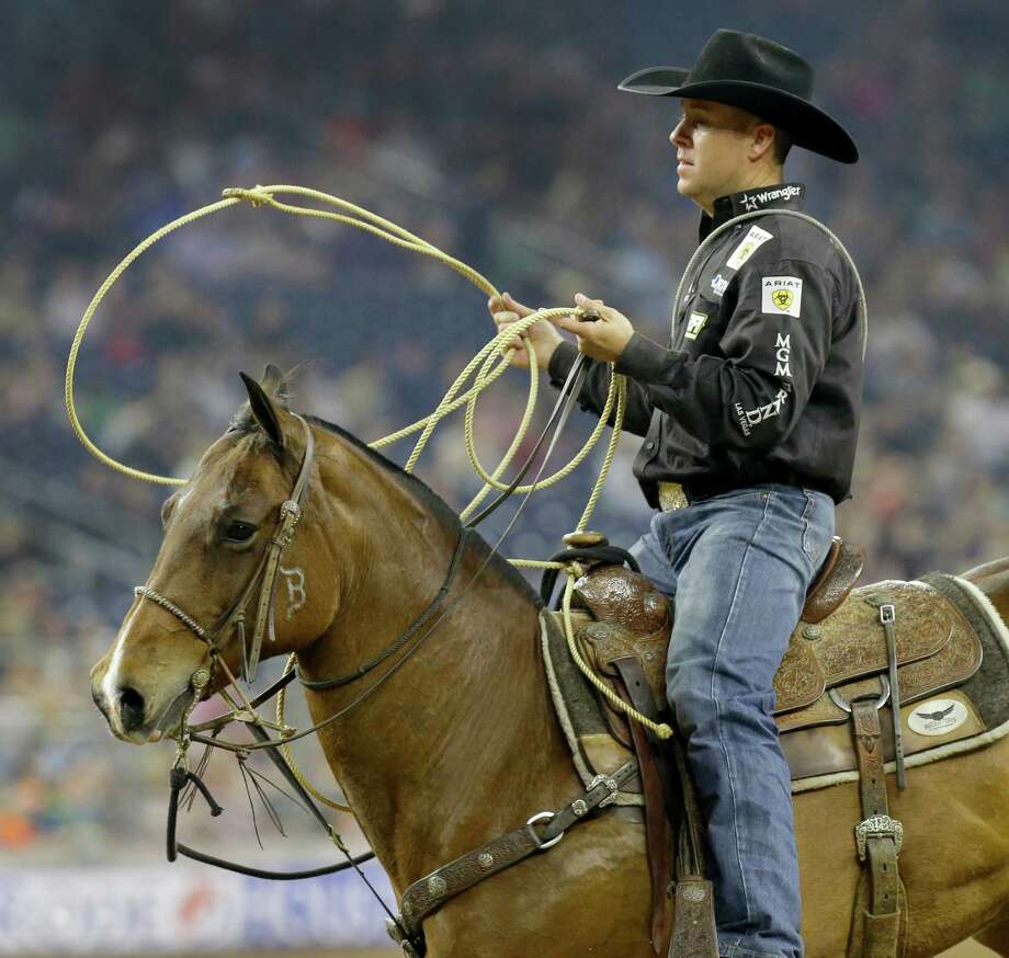Trevor Brazile rides out after competing in tie-down roping at RodeoHouston during the Houston Livestock Show and Rodeo in NRG Stadium Friday, March 18, 2016, in Houston. Photo: Melissa Phillip, Houston Chronicle / © 2016 Houston Chronicle