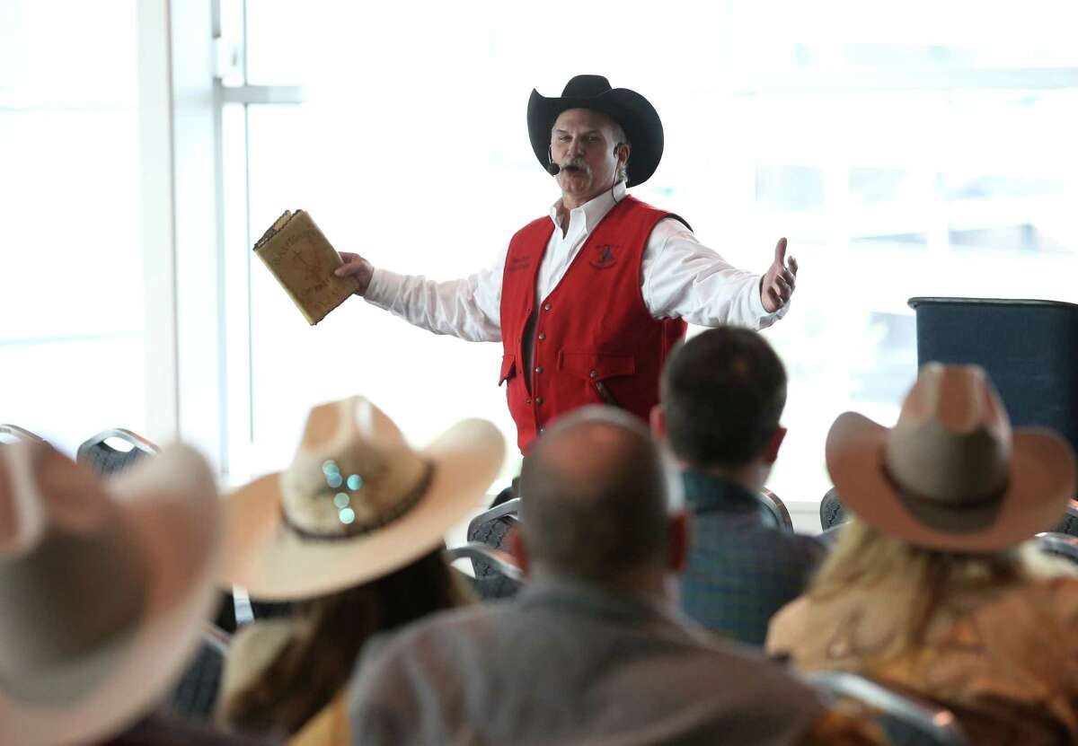 Pastor Ronnie Moyer preaches during an early service of Cowboy Church at the Houston Livestock Show and Rodeo Sunday, March 13, 2016, in Houston.
