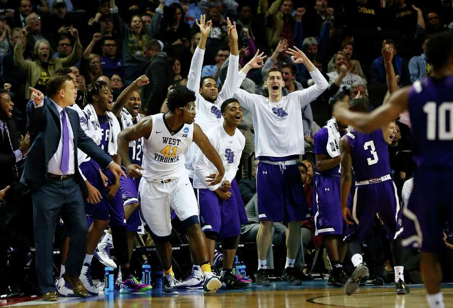 NEW YORK, NY - MARCH 18:  Jared Johnson #3 of the Stephen F. Austin Lumberjacks celebrates with his bench in the second half against the West Virginia Mountaineers during the first round of the 2016 NCAA Men's Basketball Tournament at Barclays Center on March 18, 2016 in the Brooklyn borough of New York City. Photo: Elsa, Getty Images / 2016 Getty Images