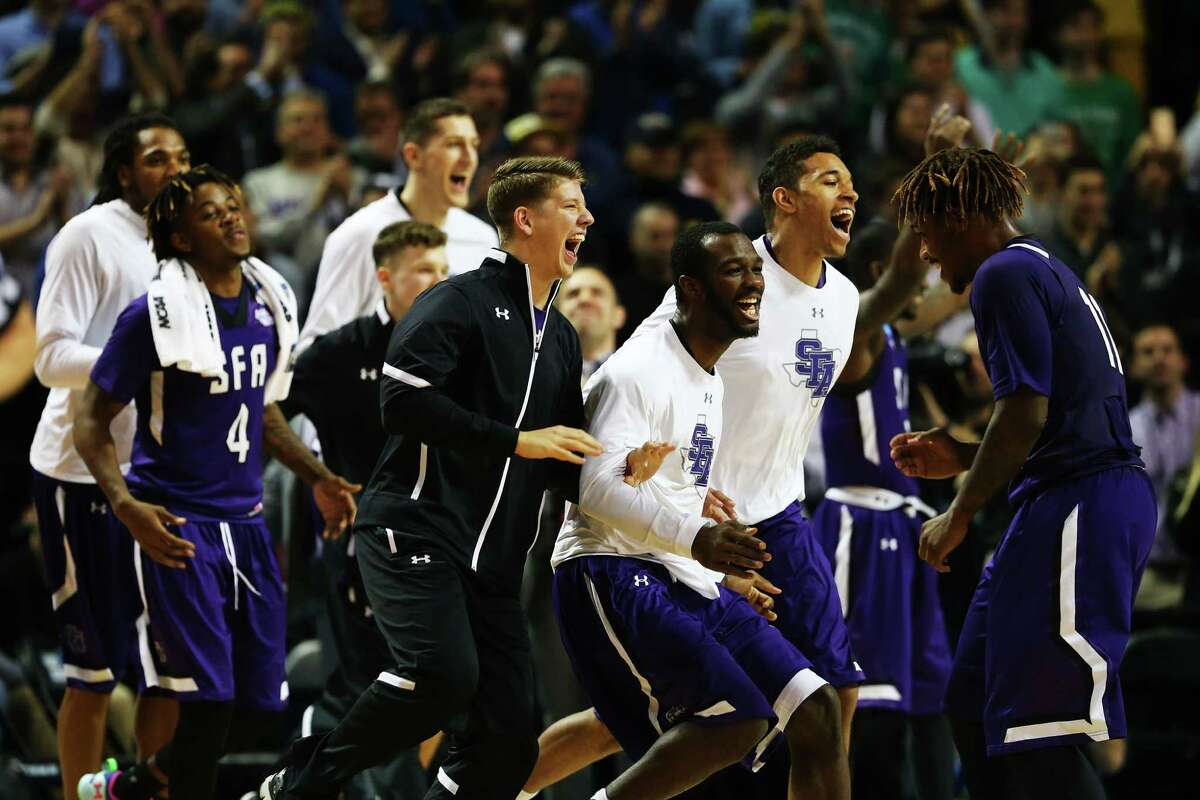 NEW YORK, NY - MARCH 18: The Stephen F. Austin Lumberjacks bench celebrates in the second half against the West Virginia Mountaineers during the first round of the 2016 NCAA Men's Basketball Tournament at Barclays Center on March 18, 2016 in the Brooklyn borough of New York City.