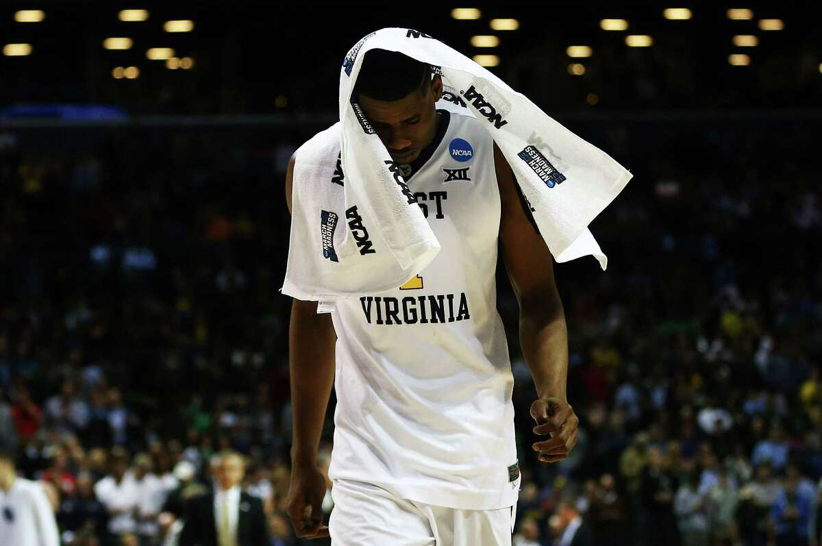 NEW YORK, NY - MARCH 18: Jonathan Holton #1 of the West Virginia Mountaineers reacts after their 56-70 loss to the Stephen F. Austin Lumberjacks during the first round of the 2016 NCAA Men's Basketball Tournament at Barclays Center on March 18, 2016 in the Brooklyn borough of New York City.