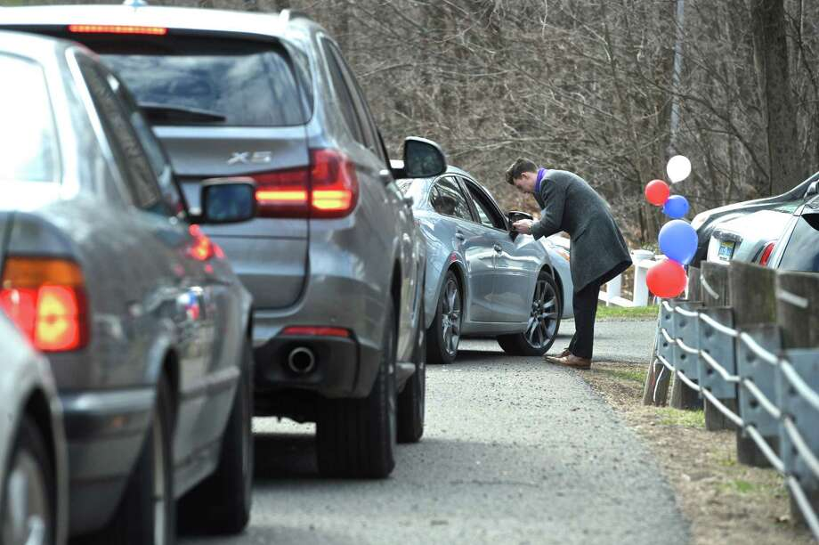 Cars line up on Good Hill Road in Roxbury as they make their way through a checkpoint to a private fundraiser attended by presidential candidate Hillary Clinton in Roxbury on Friday afternoon. Photo: H John Voorhees III / Hearst Connecticut Media / The News-Times