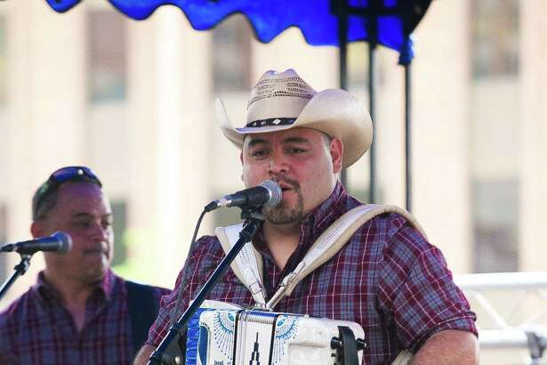 Forget SxSW, these San Antonians are staying in town to celebrate the Tejano Music Awards Fan Fai at Market Square Friday March 18, 2016.