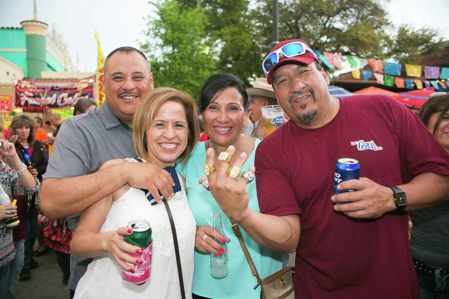 Forget SxSW, these San Antonians are staying in town to celebrate the Tejano Music Awards Fan Fair at Market Square Friday March 18, 2016. Photo: Christian Ibarra