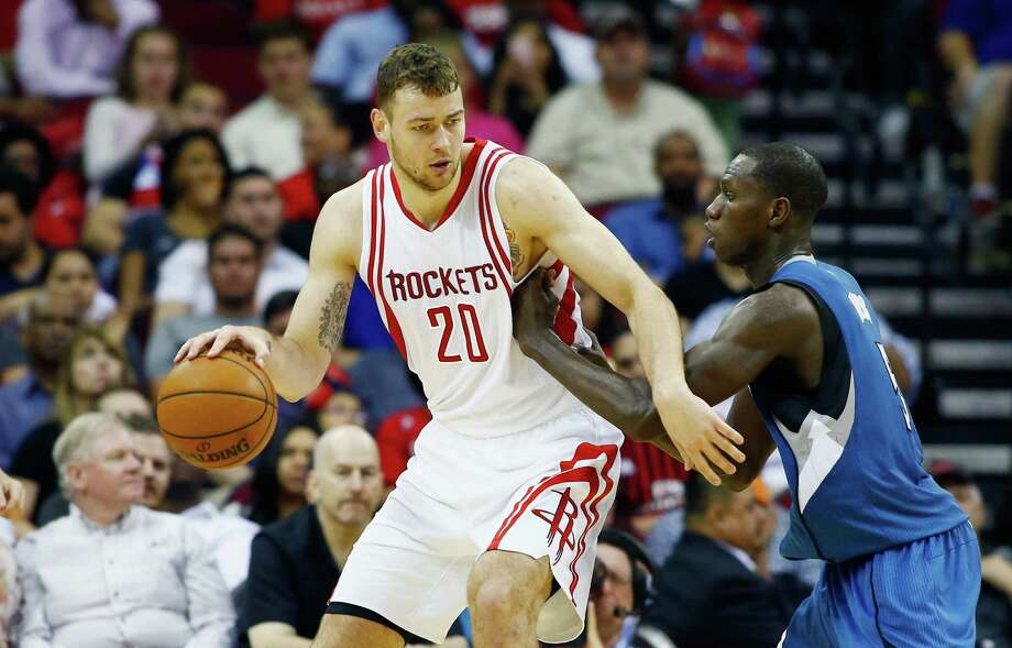 HOUSTON, TX - MARCH 18:  Donatas Motiejunas #20 of the Houston Rockets drives with the basketball against Gorgui Dieng #5 of the Minnesota Timberwolves during their game at the Toyota Center on March 18, 2016 in Houston, Texas. Photo: Scott Halleran, Getty Images / 2016 Getty Images