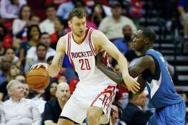 HOUSTON, TX - MARCH 18: Donatas Motiejunas #20 of the Houston Rockets drives with the basketball against Gorgui Dieng #5 of the Minnesota Timberwolves during their game at the Toyota Center on March 18, 2016 in Houston, Texas. NOTE TO USER: User expressly acknowledges and agrees that, by downloading and or using this Photograph, user is consenting to the terms and conditions of the Getty Images License Agreement.