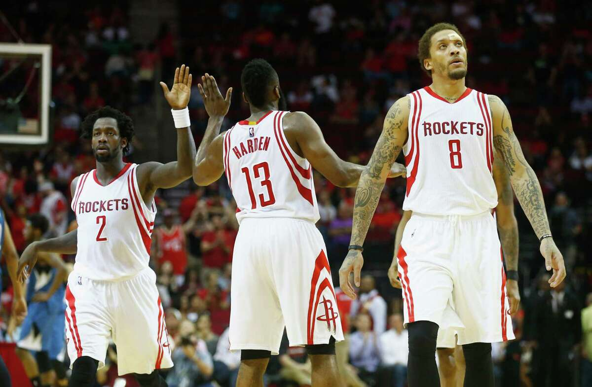HOUSTON, TX - MARCH 18: Patrick Beverley #2Minnesota Timberwolves James Harden #13 and Michael Beasley #8 of the Houston Rockets wait on the court during their game against the Minnesota Timberwolves at the Toyota Center on March 18, 2016 in Houston, Texas. NOTE TO USER: User expressly acknowledges and agrees that, by downloading and or using this Photograph, user is consenting to the terms and conditions of the Getty Images License Agreement.