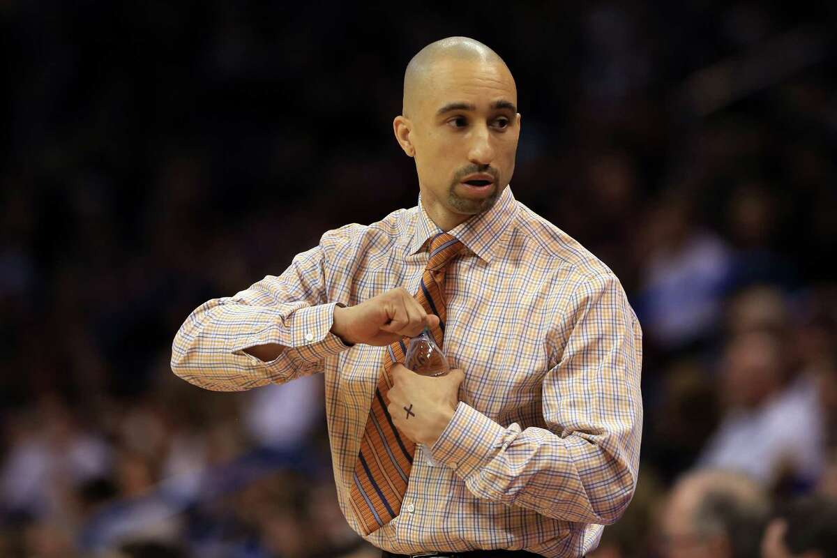 OKLAHOMA CITY, OK - MARCH 18: Head coach Shaka Smart of the Texas Longhorns looks on in the first half against the Northern Iowa Panthers during the first round of the 2016 NCAA Men's Basketball Tournament at Chesapeake Energy Arena on March 18, 2016 in Oklahoma City, Oklahoma.