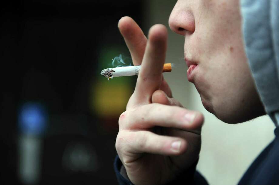 Lawmakers are attempting to raise the legal smoking age to 21 in Texas. >>Click to see Texas cities with comprehensive smoking bans. Photo: Autumn Driscoll / Autumn Driscoll / Connecticut Post