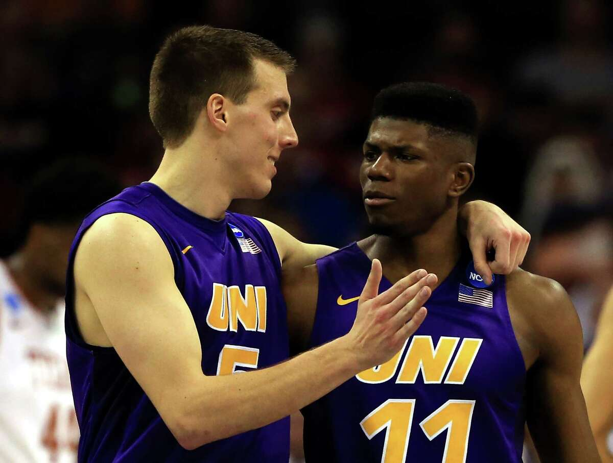 OKLAHOMA CITY, OK - MARCH 18: Wes Washpun #11 of the Northern Iowa Panthers celebrates with Matt Bohannon #5 in the second half against the Texas Longhorns during the first round of the 2016 NCAA Men's Basketball Tournament at Chesapeake Energy Arena on March 18, 2016 in Oklahoma City, Oklahoma.