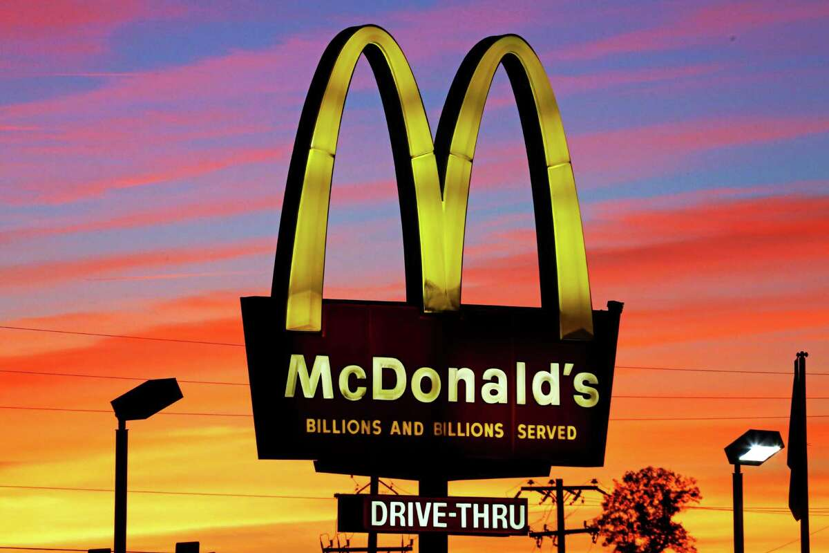 """In this Saturday, Oct. 10, 2015, photo, the sun sets behind a McDonald's in Ebensburg, Pa. McDonald's hopes it has a catchy, new deal that will be as hugely popular as its Dollar Menu. Starting Jan. 4, 2016, the fast-food chain will launch the """"McPick 2"""" menu, which will let customers pick two of the following items for $2: a McDouble, a McChicken, small fries and mozzarella sticks. (AP Photo/Gene J. Puskar)"""