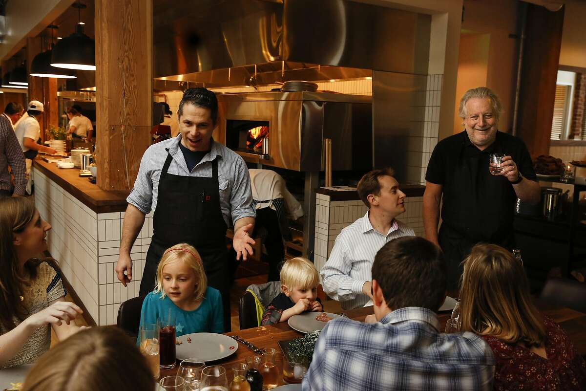 Opening night of Waxman restaurant at Ghirardelli Square in San Francisco, California on Friday March 18, 2016. This table is Jonathan Waxman's brother's family from Berkeley. Jonathan Waxman is on the far right, his nephew Aaron Waxman is sitting down to the left and waiter Edward Battenberg is at the left.