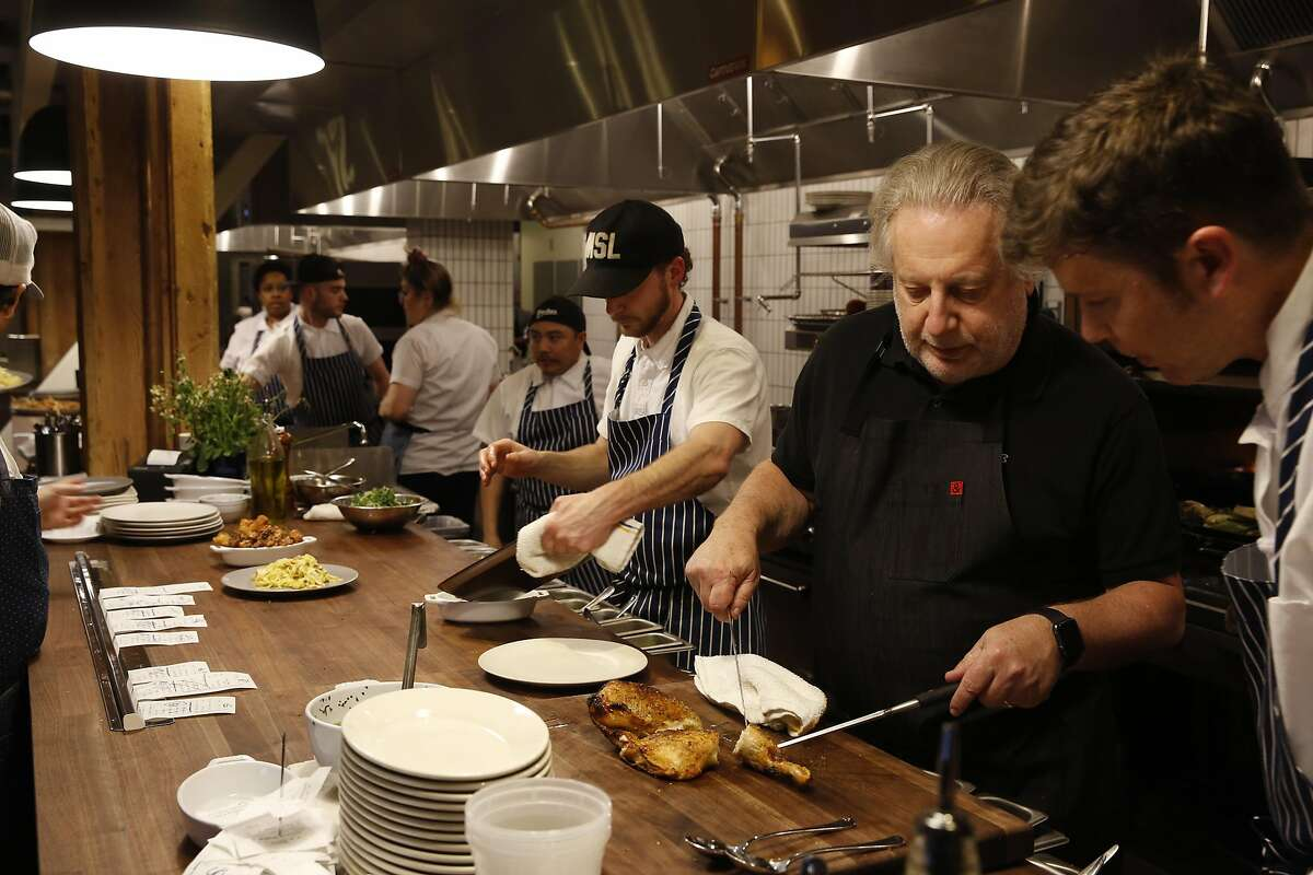 Chef Jonathan Waxman (right) on opening night of his Waxman restaurant at Ghirardelli Square in San Francisco, California on Friday March 18, 2016.