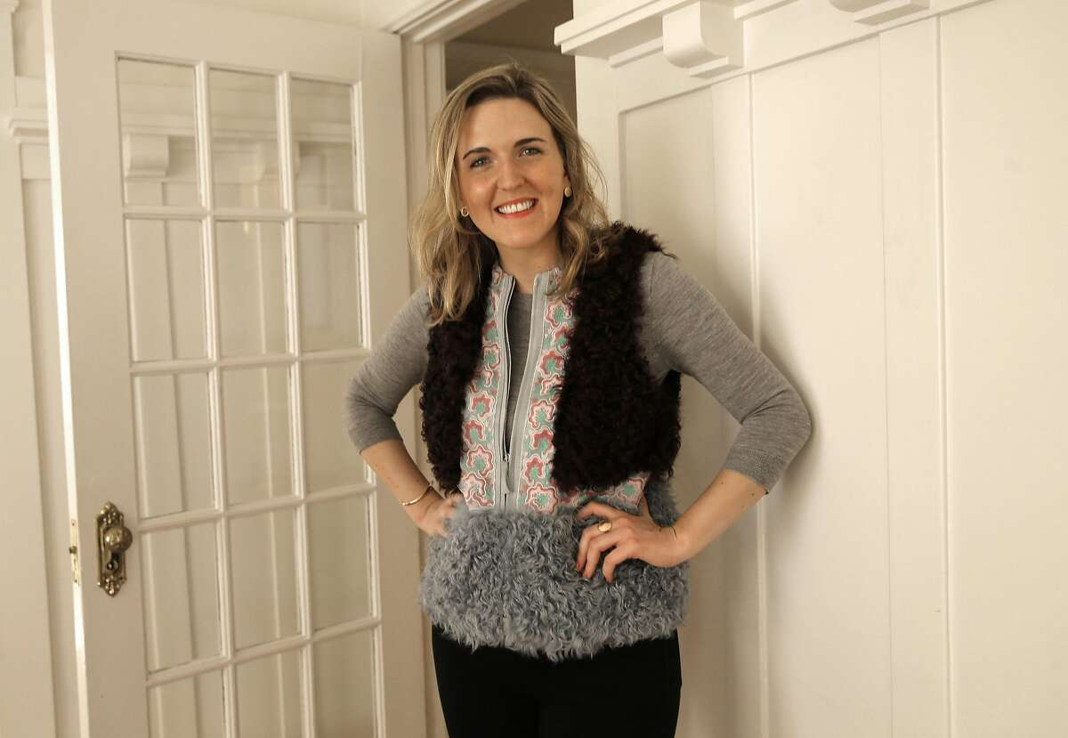 Mary Doyle models a Giambi, bordeaux fur vest at her home on Fri. March 18, 2016, in San Francisco, California. Doyle has been using Rent the Runway an online business that rents designer fashions for special events.