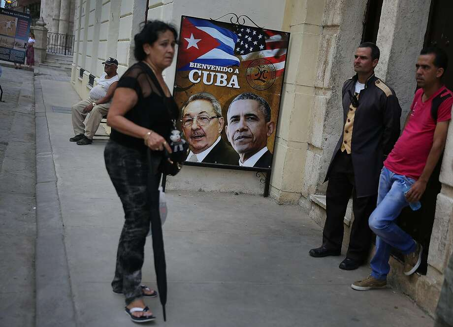 A sign with Cuban President Raul Castro and U.S. President Obama is seen in Havana on the eve of Obama's visit. Photo: Joe Raedle, Getty Images