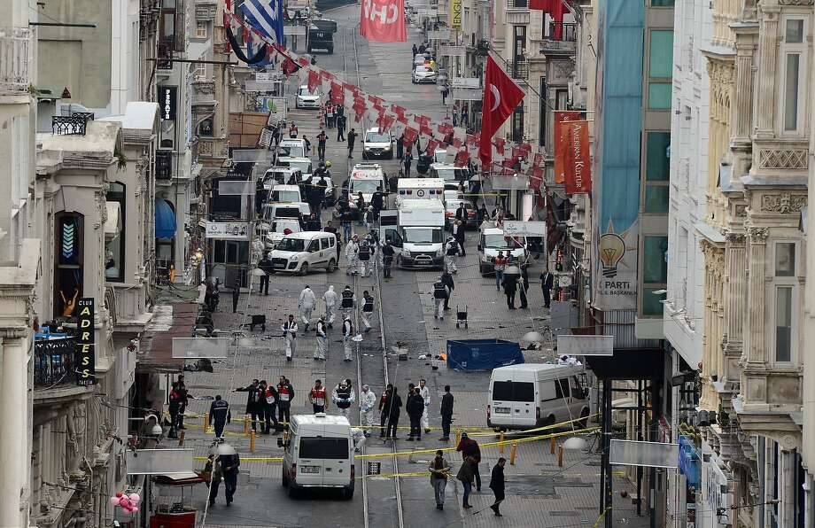 Emergency teams examine the scene of the explosion on a major shopping street popular with tourists and locals in Istanbul. Photo: Ismail Coskun, AP