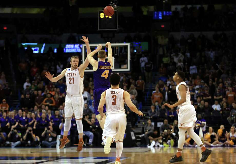 Paul Jesperson follows through on his game-winning shot from half court over Texas' Connor Lammert, a Churchill product. Photo: Tom Pennington / Getty Images / 2016 Getty Images